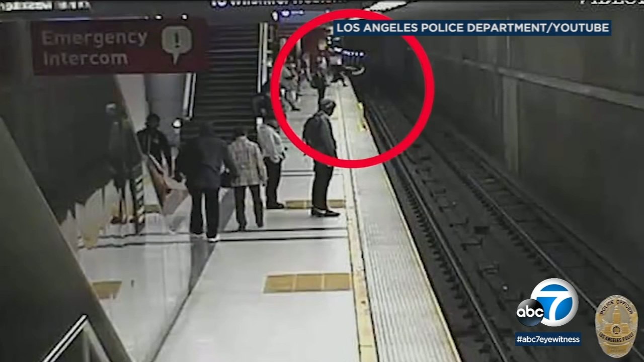 Recently-released video shows the shocking events leading to the death of an assault suspect accused of pushing a teen onto train tracks in downtown Los Angeles back in Decemeber.