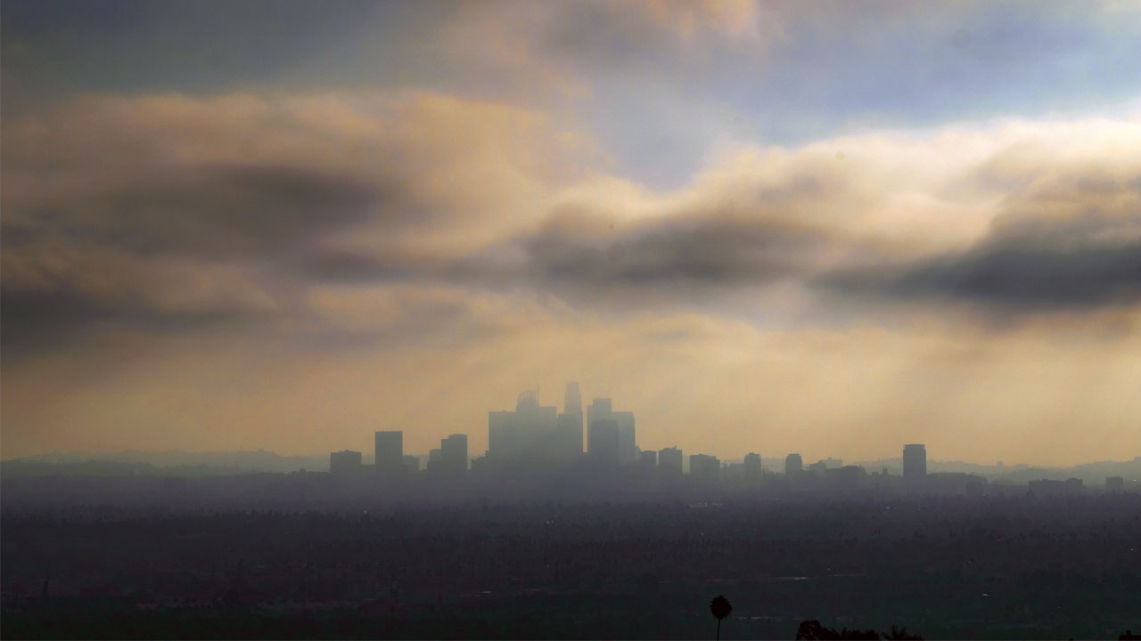 In this Aug. 12, 2016, file photo, downtown Los Angeles is shrouded in early morning coastal fog.