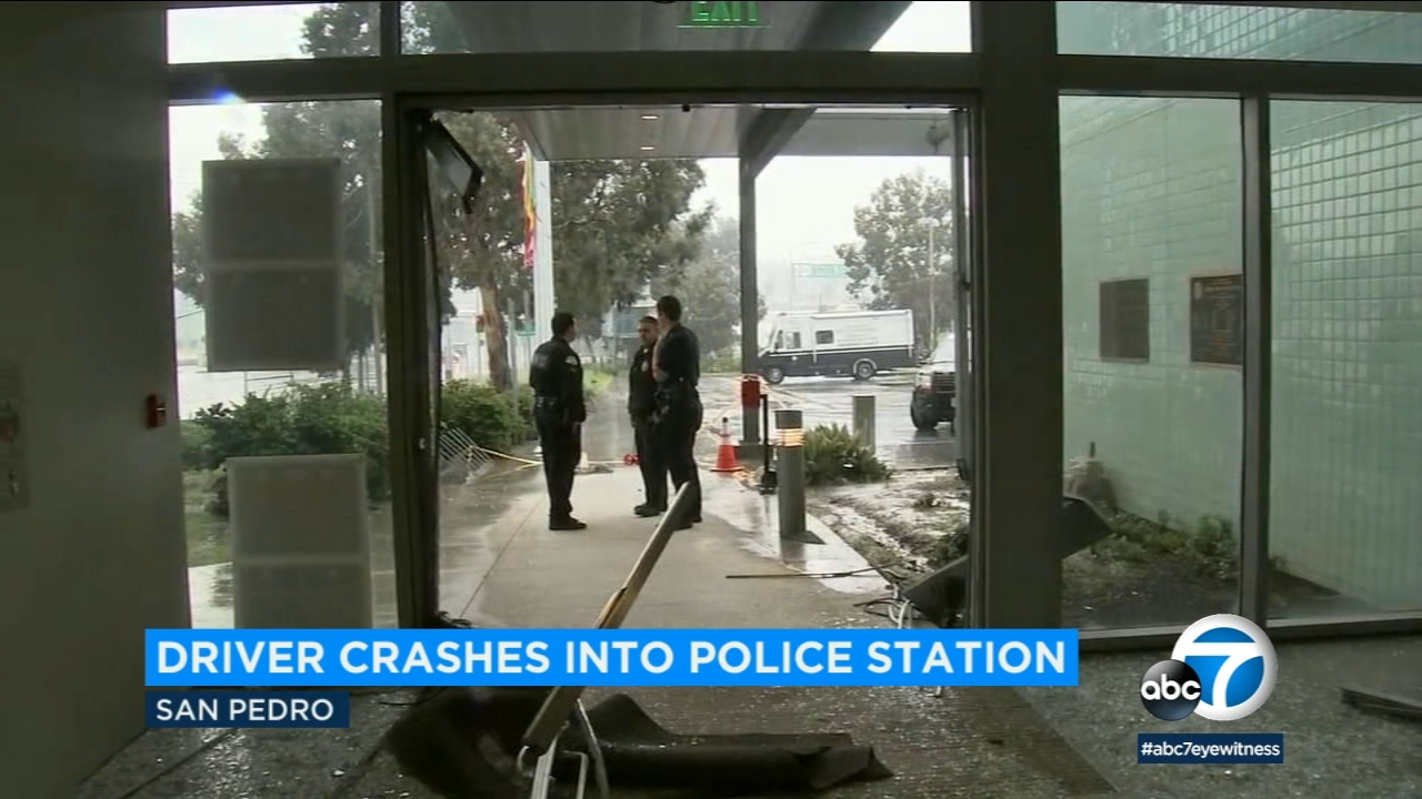 A woman who may have been driving under the influence with a baby in her car crashed into the lobby of an LAPD station in San Pedro, officials said.