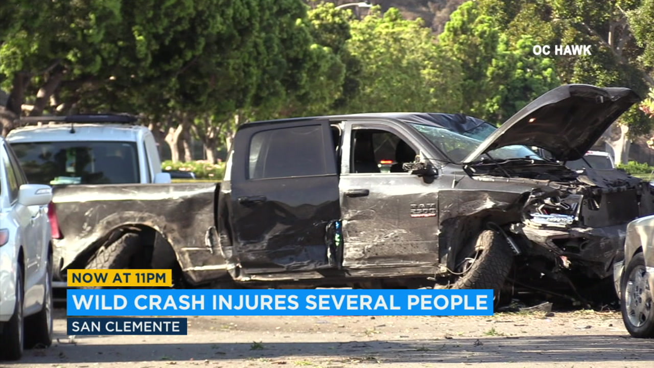 An out-of-control pickup truck slammed into a light pole and four parked cars in San Clemente, creating a domino effect that injured two bicyclists and a pedestrian.