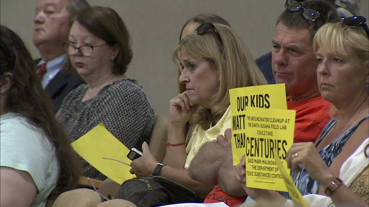 Simi Valley residents held signs as they all voiced their concerns over the idea to use groundwater as drinking water in the event of natural disasters.