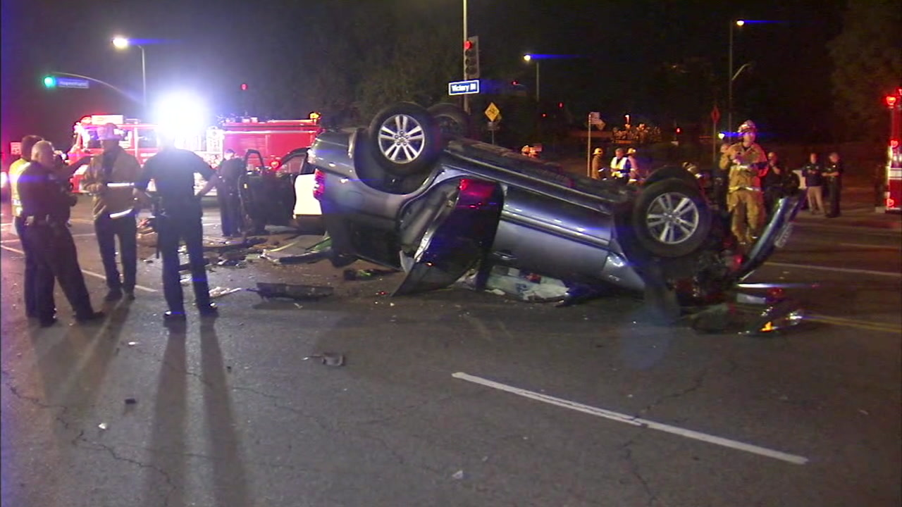 An overturned vehicle is shown after it was involved in a crash with other vehicles and an LAPD cruiser in Lake Balboa.
