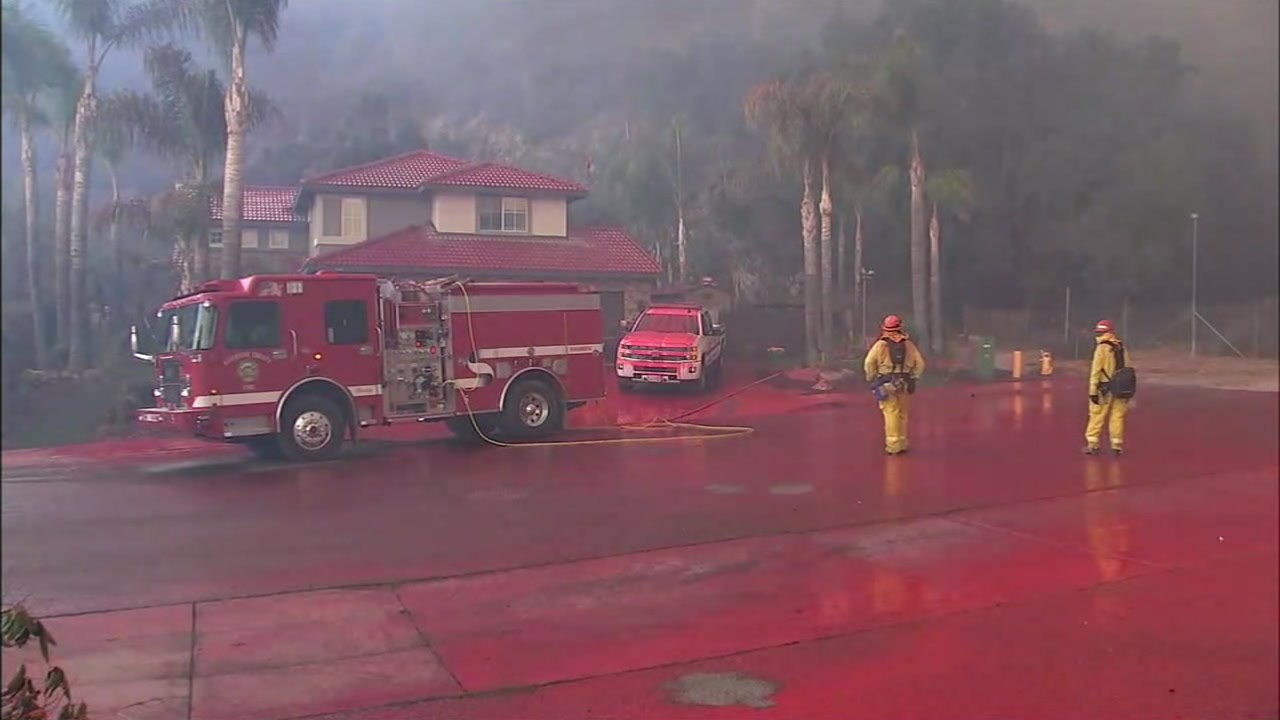 Amid Holy Fire, Lake Elsinore residents clean up pink fire retardant