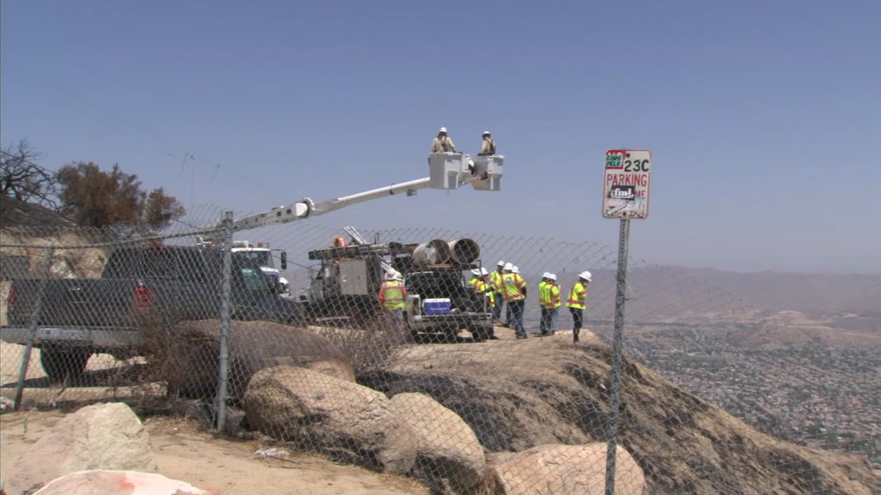 Crews are working to restore power after utility poles were damaged by the Holy Fire in Orange and Riverside counties.