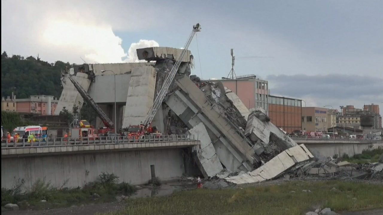 A huge section of the Morandi Bridge collapsed at mid-day over an industrial zone, sending tons of twisted steel and concrete debris onto warehouses below.