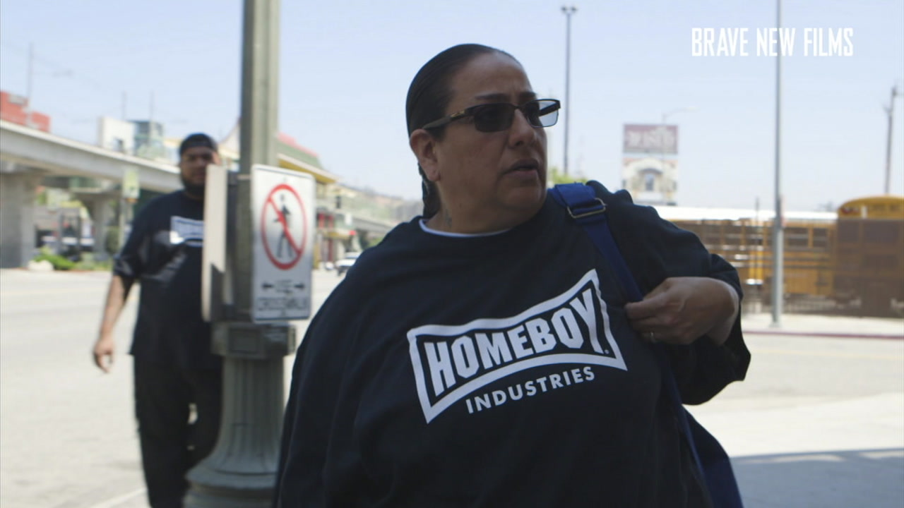 A former gang member, Emily Chapa, is shown wearing a Homeboy Industries shirt as she leaves work at the organization for the day.