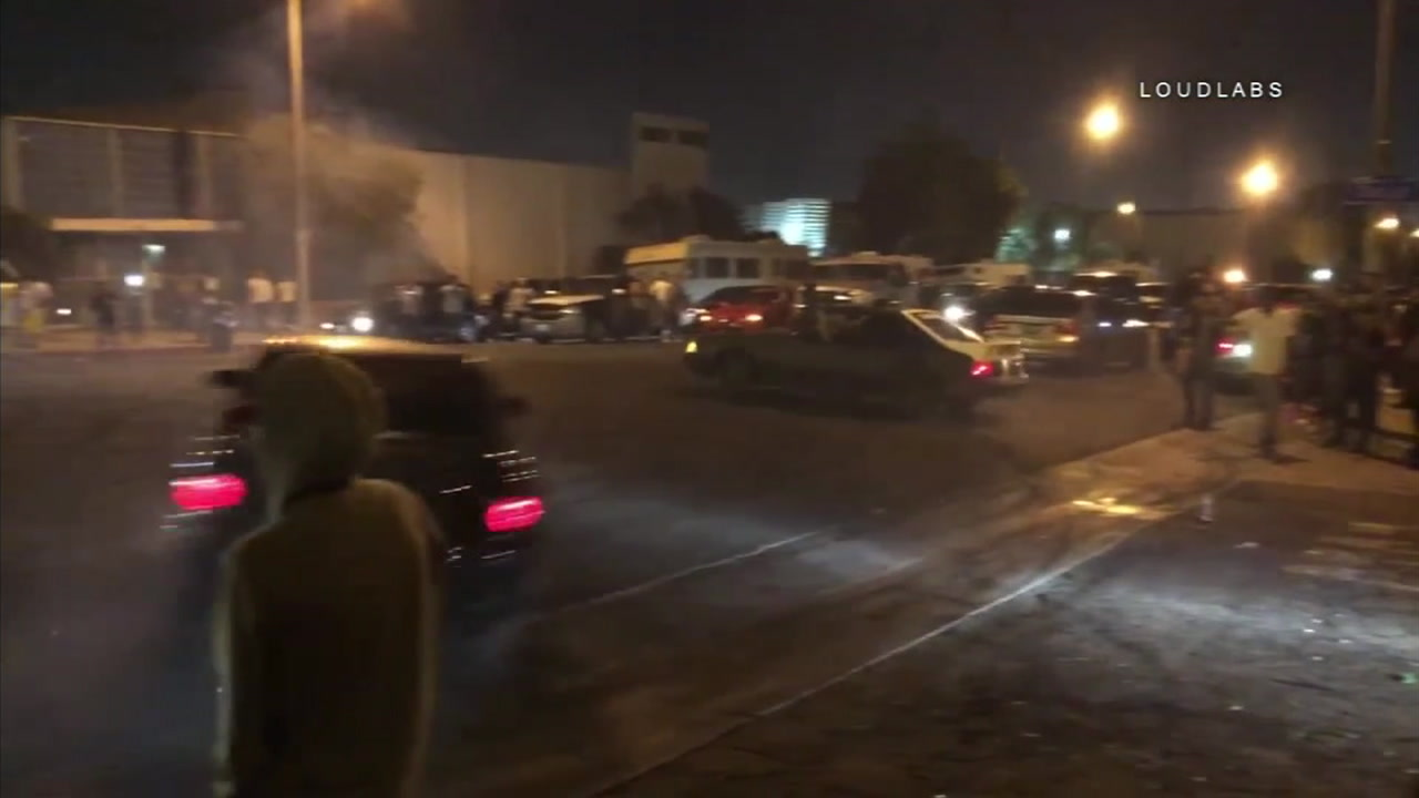 Illegal street racing is shown somewhere in the San Fernando Valley.