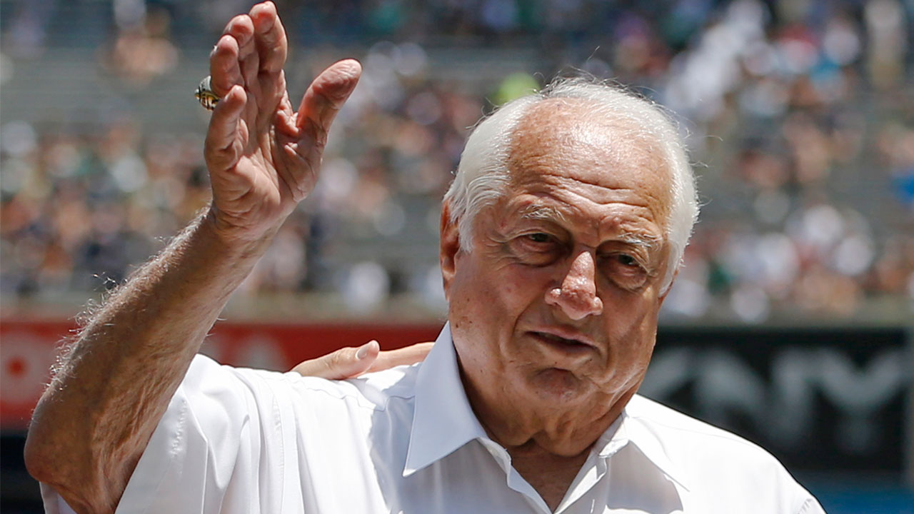 Hall of Fame manager Tommy Lasorda waves to the crowd before a baseball game at Yankee Stadium in New York, Wednesday, June 10, 2015.