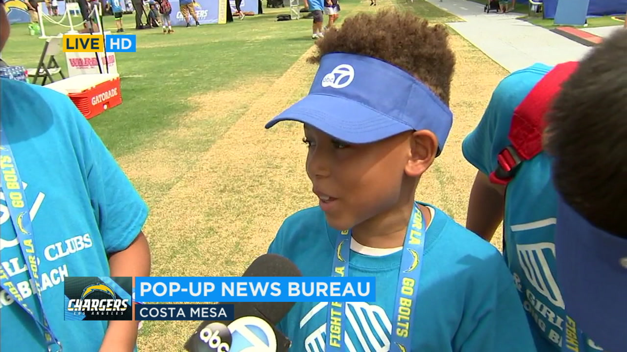 Young fans spent Monday at Los Angeles Chargers training camp in Costa Mesa participating in games and activities.