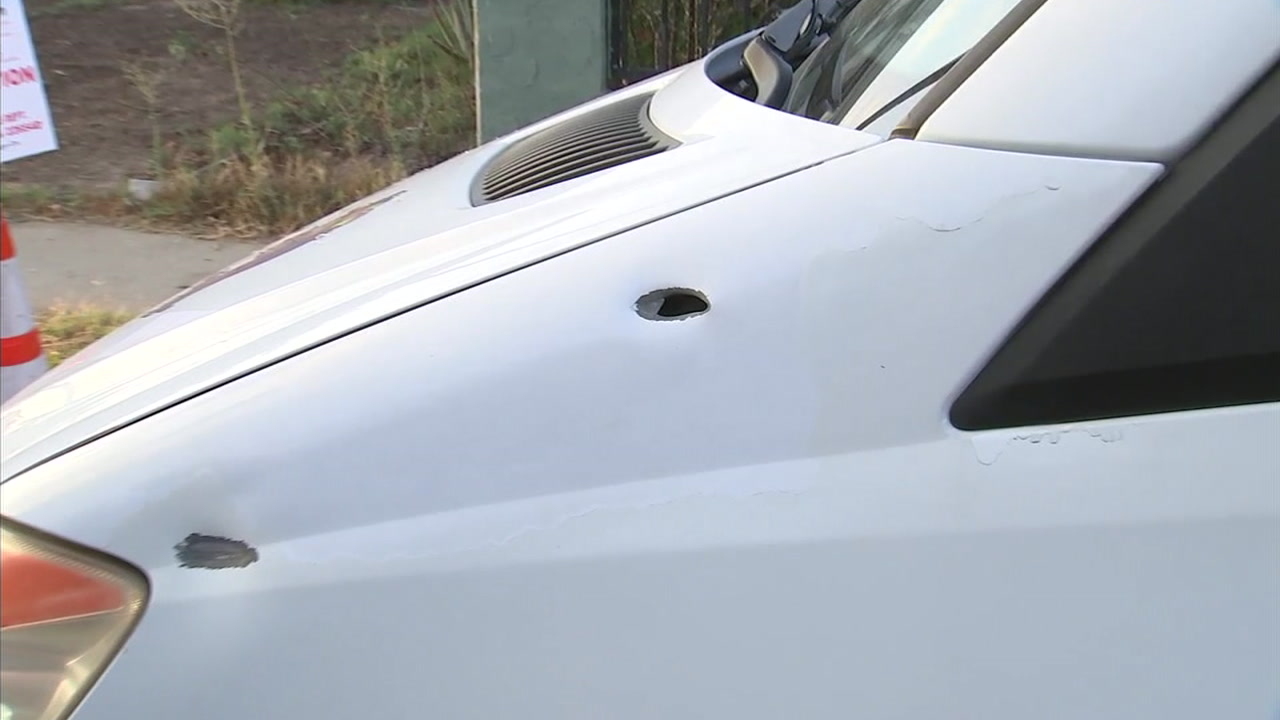 Bullet holes are shown in a vehicle after a gang shootout erupted in an Inglewood neighborhood that left a 13-year-old boy wounded.