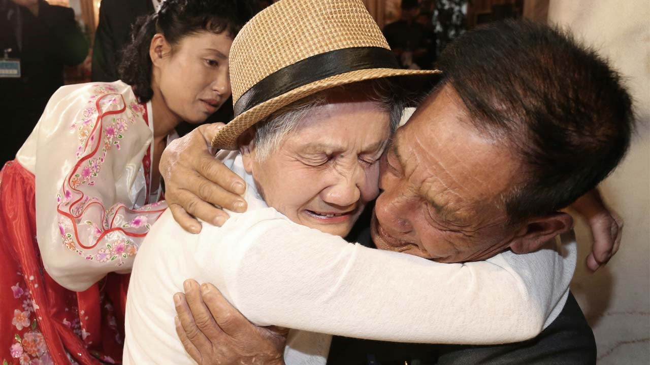South Korean Lee Keum-seom, 92, weeps as she meets with her North Korean son Ri Sang Chol, 71, during the Separated Family Reunion Meeting in North Korea, Monday, Aug. 20, 2018.