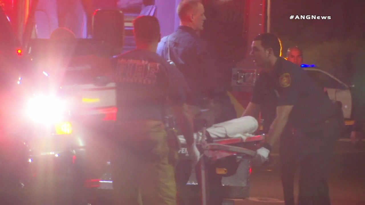 Paramedics transport a suspect following an officer-involved shooting on Monday, Aug. 20, 2018.
