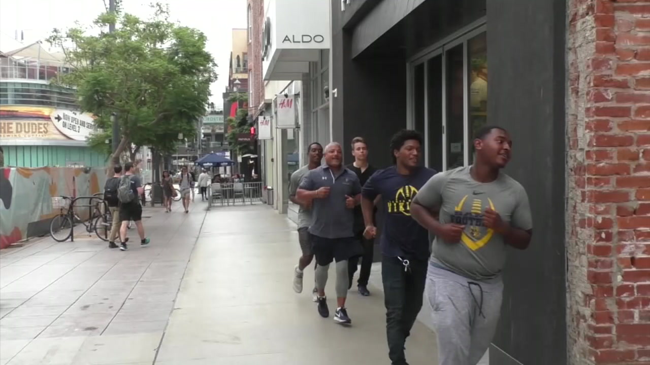 Santa Monica High School football players jog to their local Active shop in an effort to win $25,000 for their program.