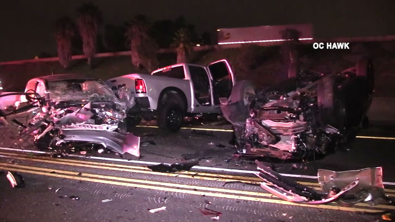 Three of several vehicles are seen mangled after a deadly crash on the 5 Freeway in Irvine on Thursday, Aug. 23, 2018.