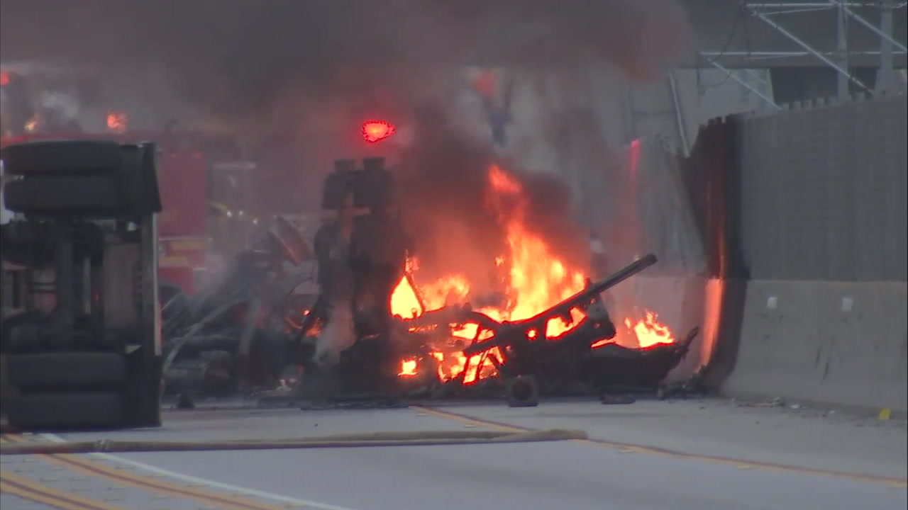 The scene of a deadly, fiery crash on the 105 Freeway that shut down lanes for several hours on Friday, Aug. 24, 2018.