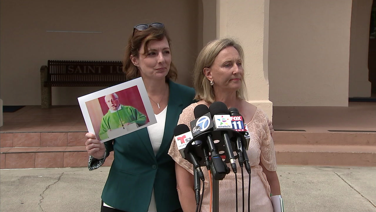 Catherine Bergin, who claims a Catholic priest sexually abused her at a Manhattan Beach church, speaks and shows a photo of him during a press conference.
