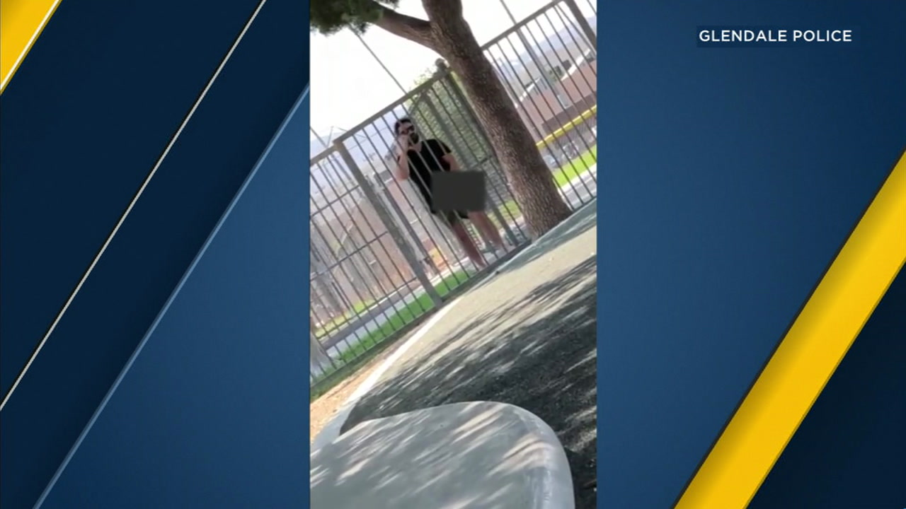 Witness video shows a man touching his genitals over his clothing as he stands near a fence at a childrens park in Glendale.