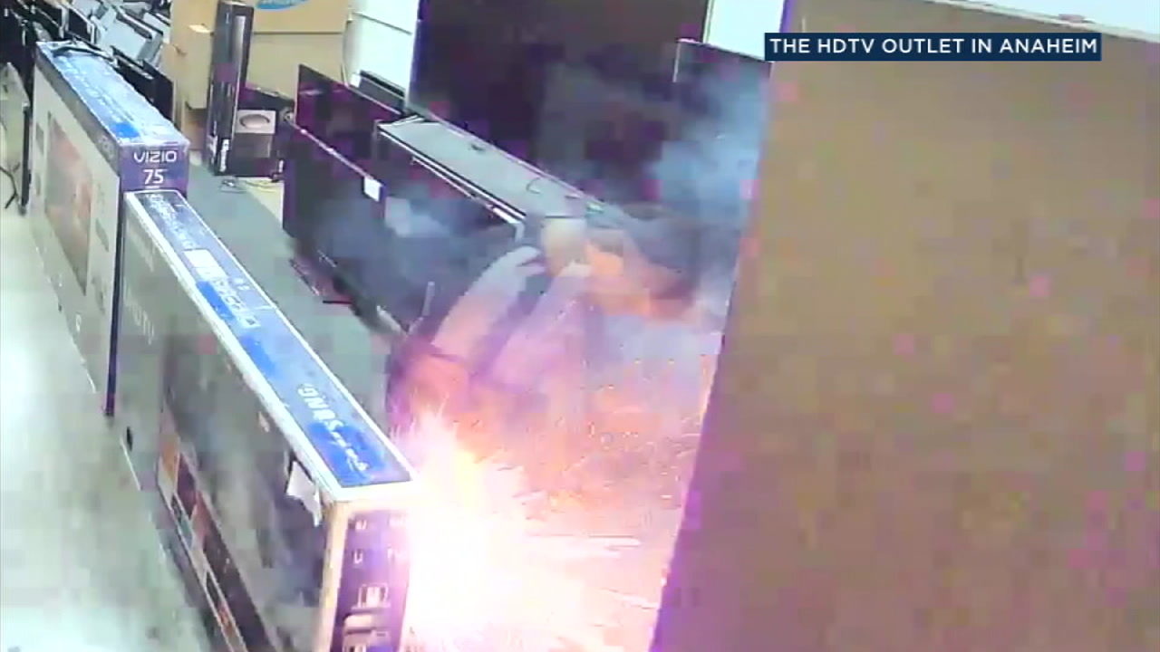 Surveillance video shows an e-cigarette exploding in a mans pants pocket while hes inside an Anaheim television store.
