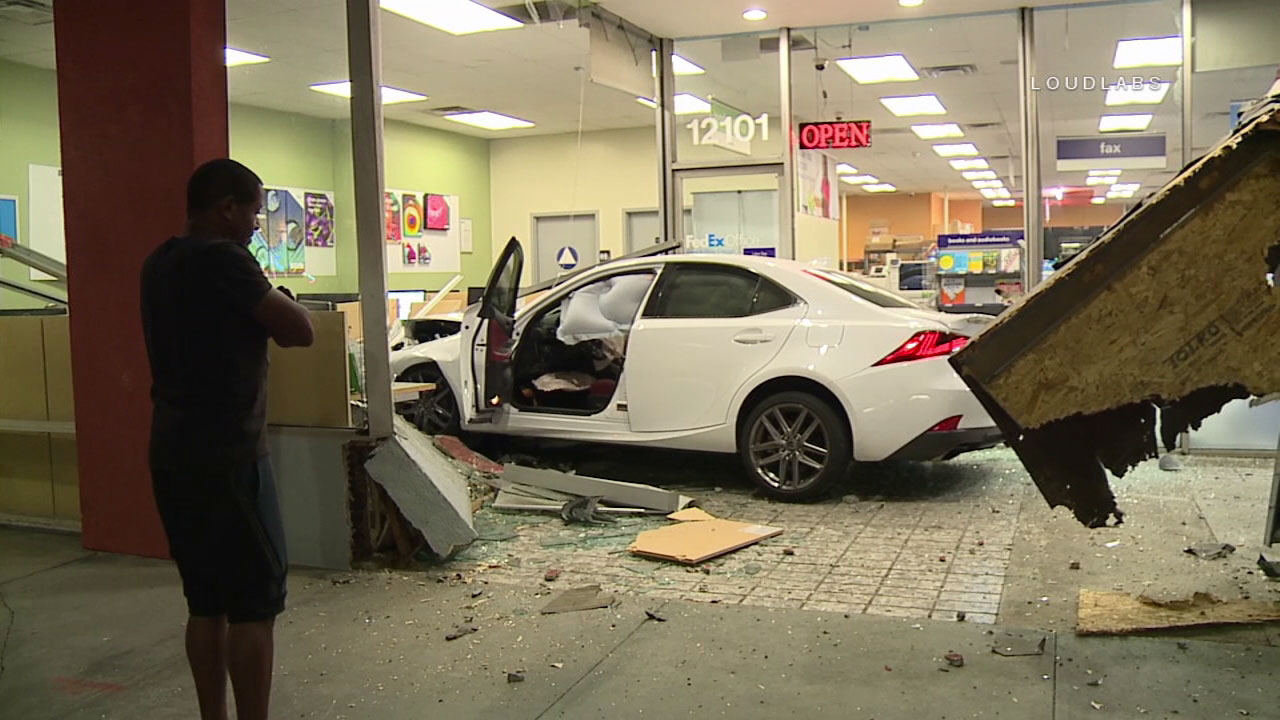A possible street racing crash early Wednesday sent a car smashing into the front of a FedEx store in Studio City.