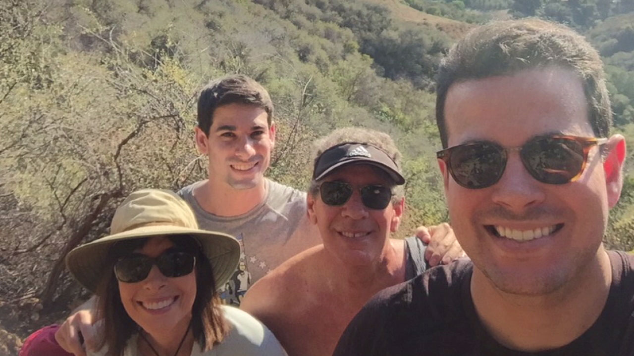 A family photo with Josh Haskell, his parents and brother hiking in Pacific Palisades.
