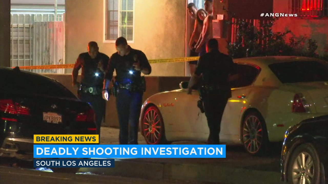 Authorities investigate the fatal shooting of a man in South Los Angeles on Wednesday, Aug. 29, 2018.