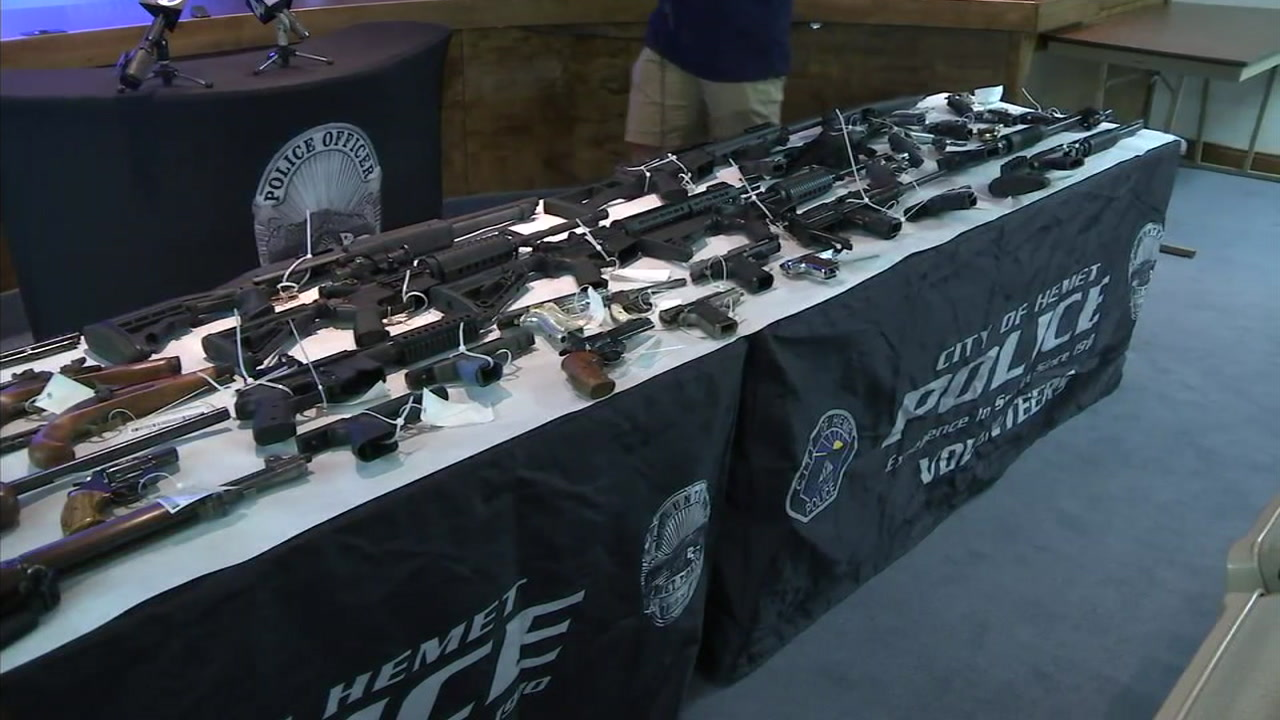 Guns seized during a gang sweep are shown during a press conference held by the Riverside County Sheriffs Department.