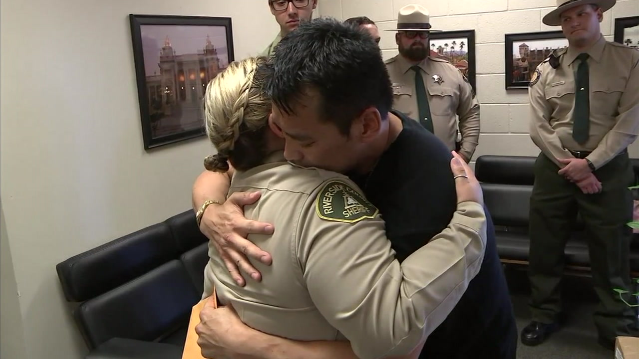 John Duczakowski and Brandi Iniguez hug after meeting in person.