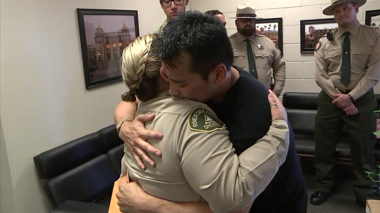 John Duczakowski and Brandi Iniguez hug after meeting in person.