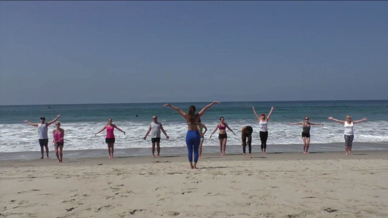 Yoga on the beach in Santa Monica provides stunning views and waves to keep you cool.