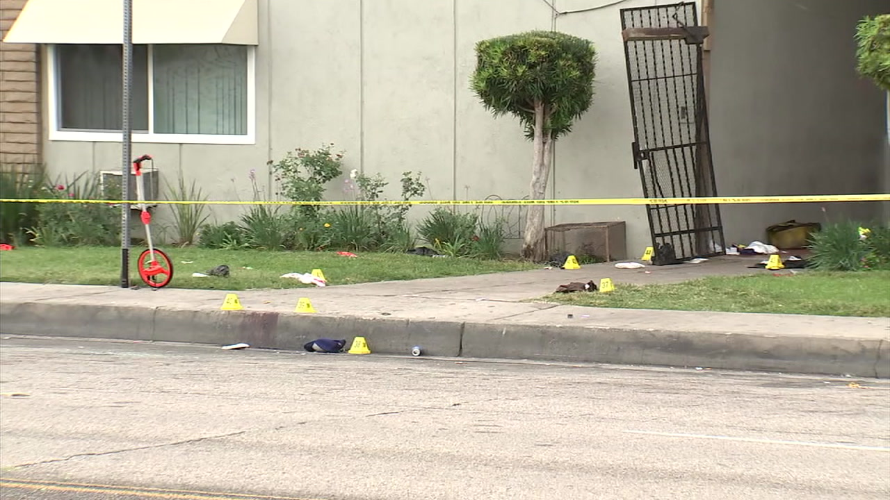 Markers and police tape cover an area where a shooting took place at a San Bernardino apartment complex.