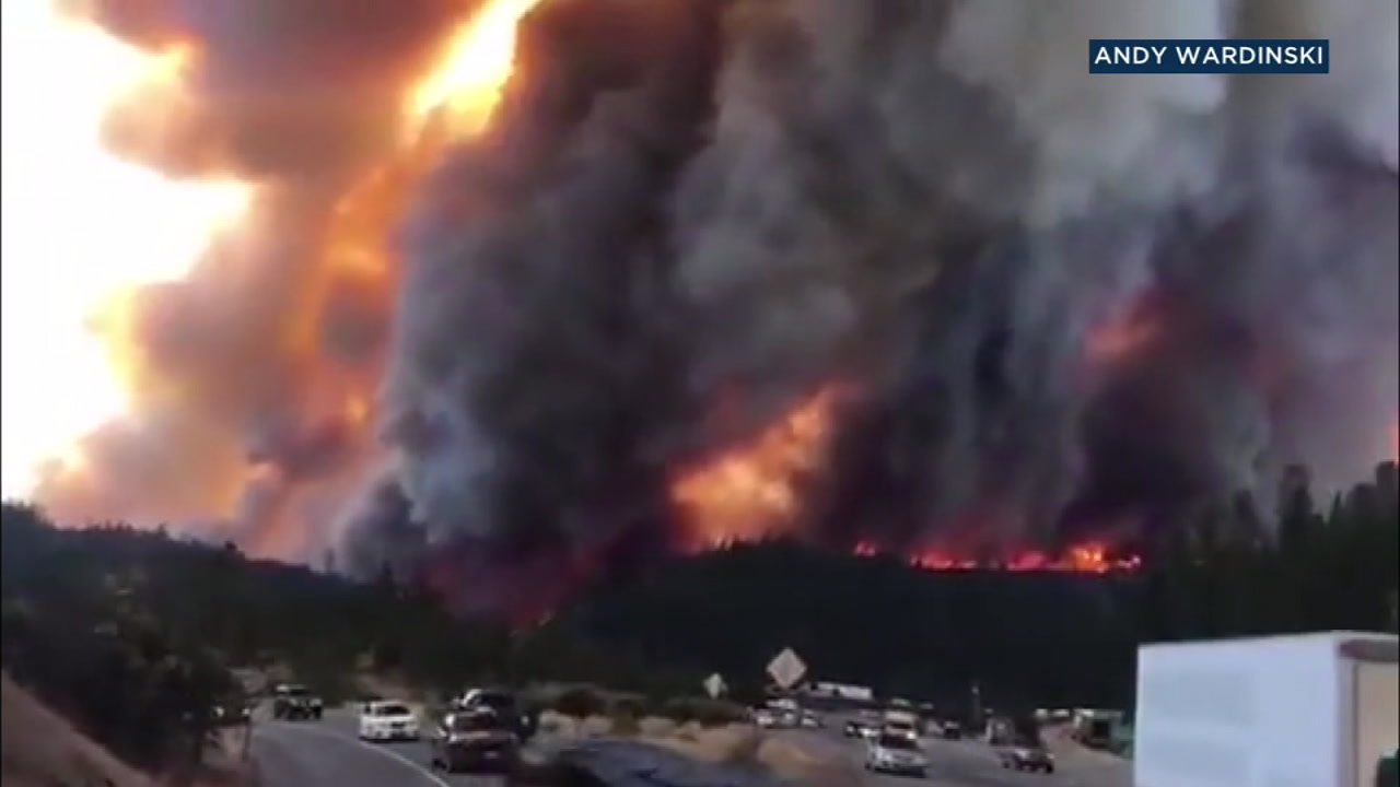 Smoke and flames are captured in a photo as people flee the I-5 Freeway in Redding as the Delta Fire rips through the region.