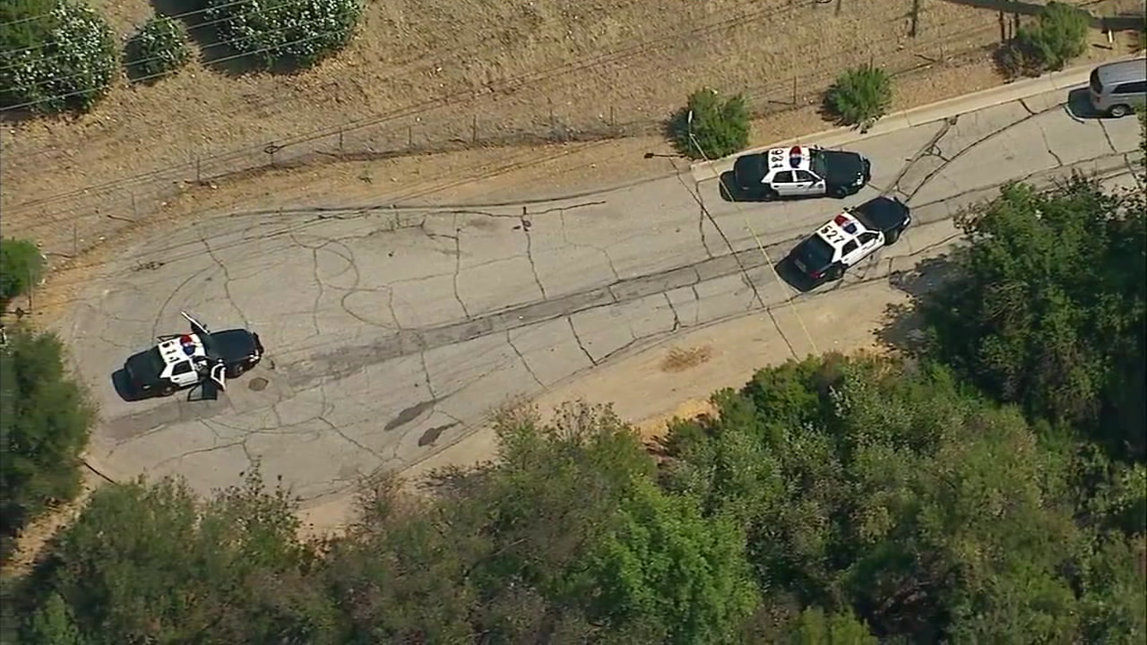 Los Angeles County sheriffs investigators process the scene where the skeletal remains of a man were found Wednesday.