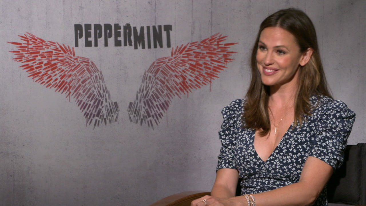 Jennifer Garner smiles during an interview for Peppermint.