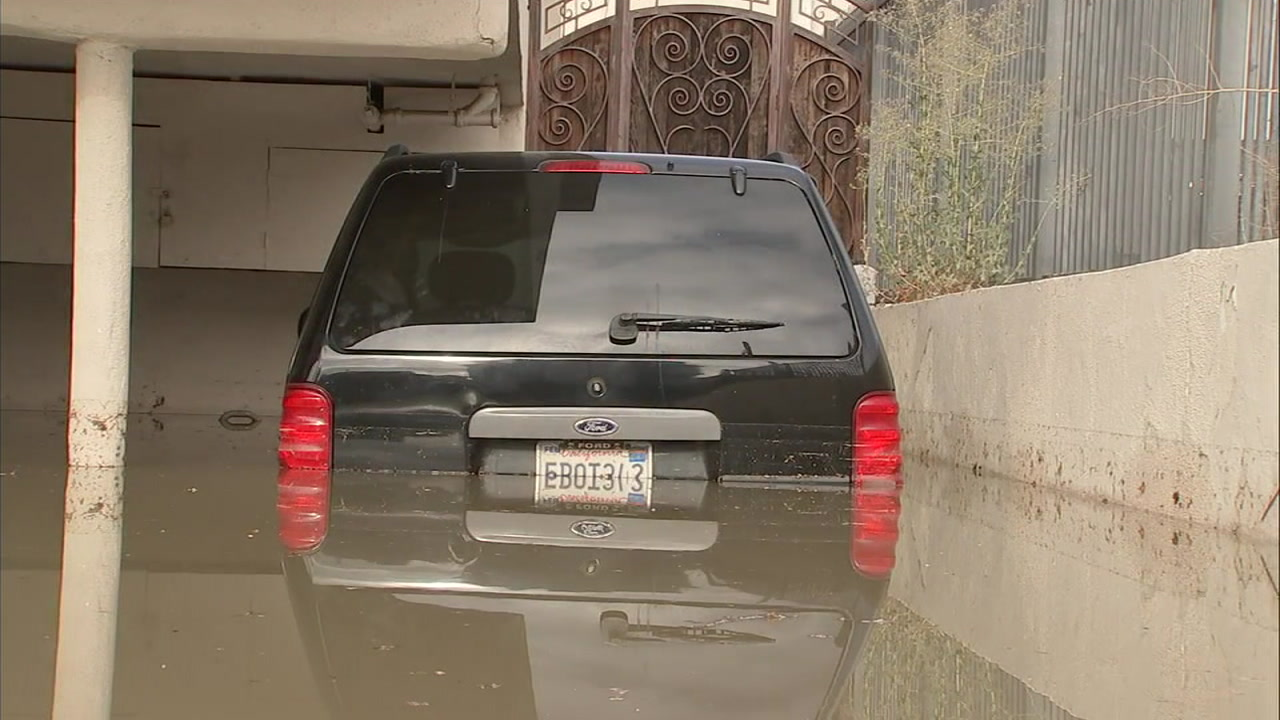 A car became partially submerged inside a carport in Hollywood on Thursday, Sept. 6, 2018.