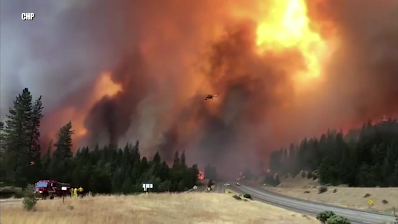 Flames from the Delta Fire are seen burning near a highway on Friday, Sept. 7, 2018.