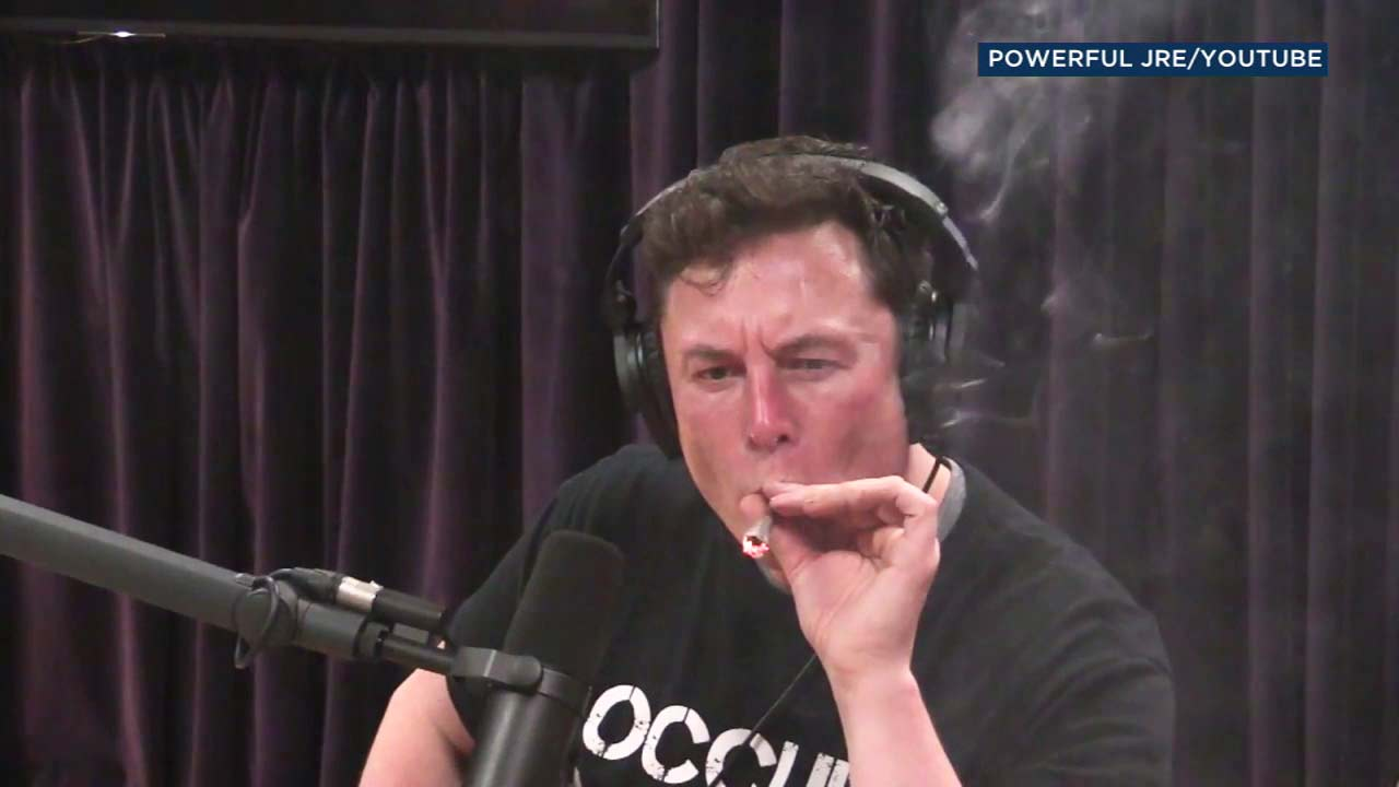 Elon Musk smokes a substance given to him by comedian Joe Rogan, who told the Tesla CEO it was marijuana wrapped in tobacco leaves.