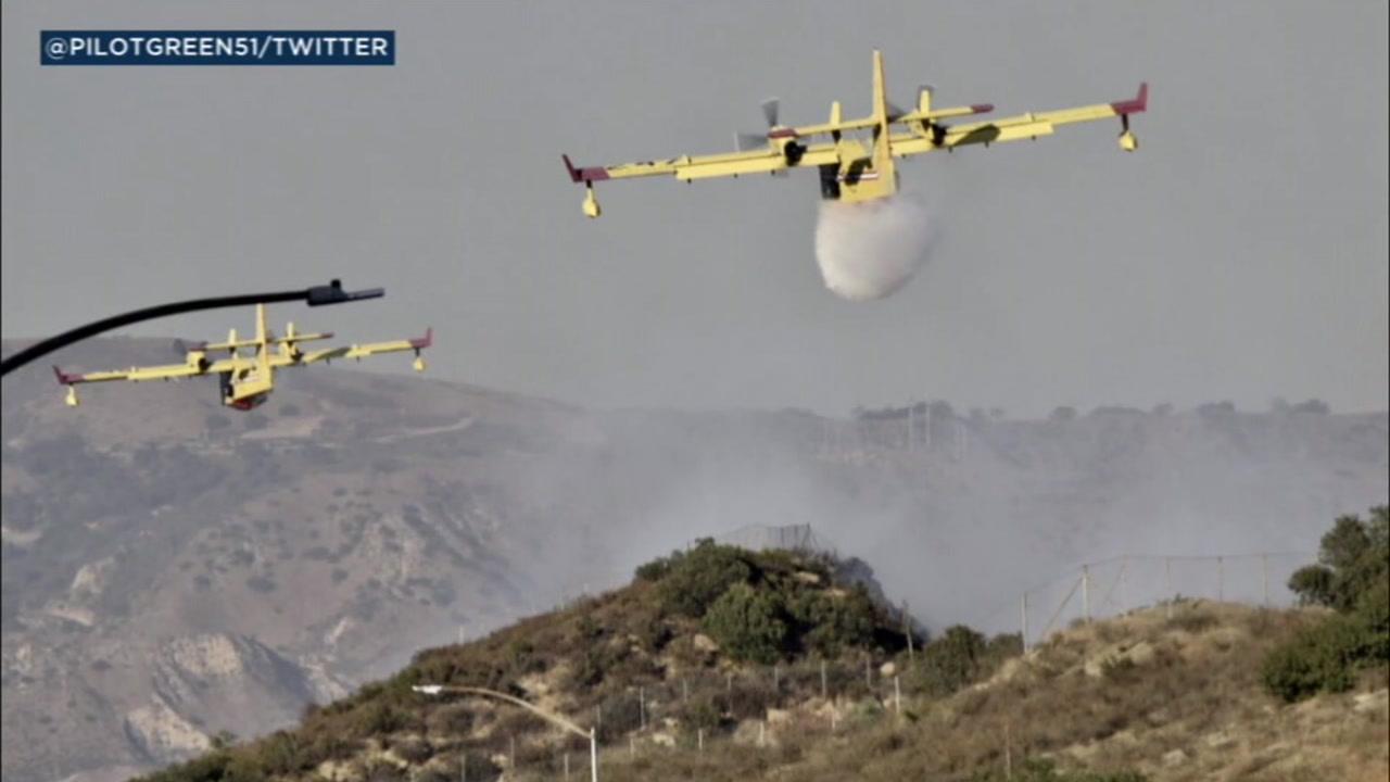 With help from water-dropping aircraft, firefighters were able to stop the forward progress of a blaze in the Santa Susana Pass after it consumed about 10 acres.