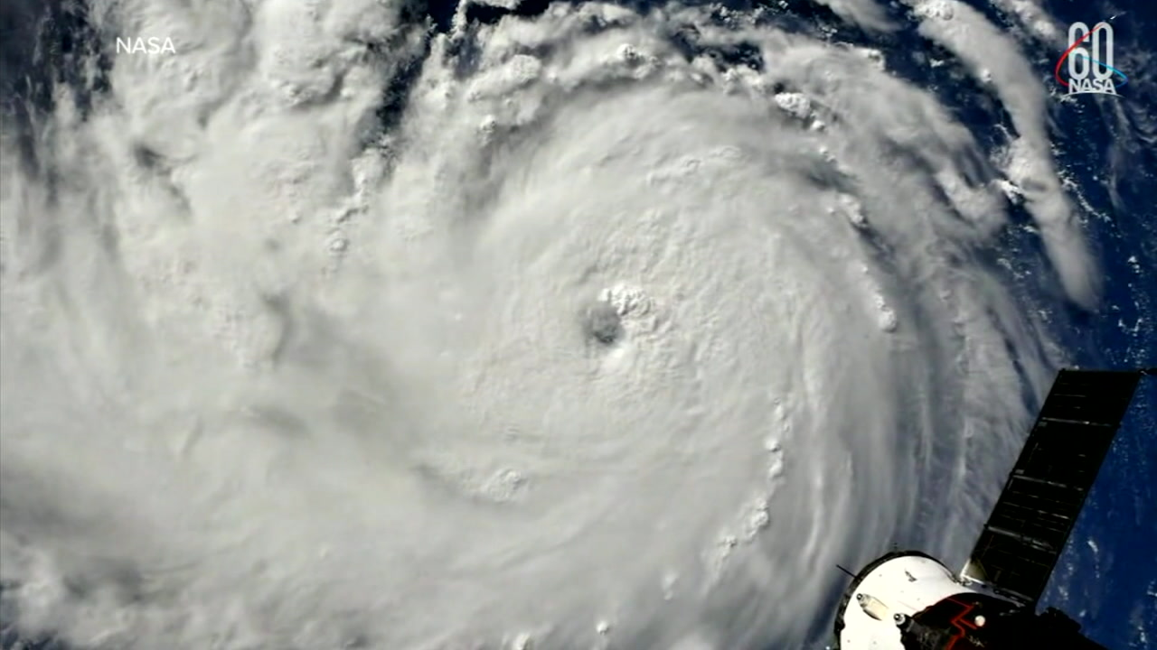 Hurricane Florence is shown in a satellite image that captured the eye and full scale of the storm.