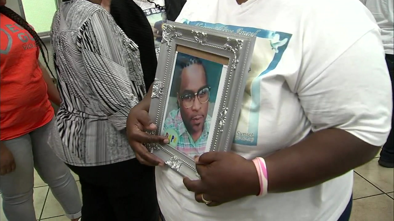 Mother Barbara Pritchett holds a photo of one of her two sons who was murdered.