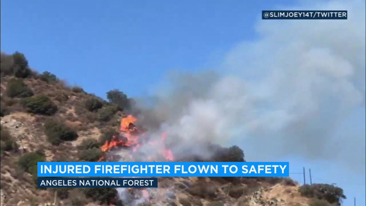 A 60-acre brush fire in the Angeles National Forest above Azusa left a firefighter injured and prompted evacuations for area visitors on Sunday.