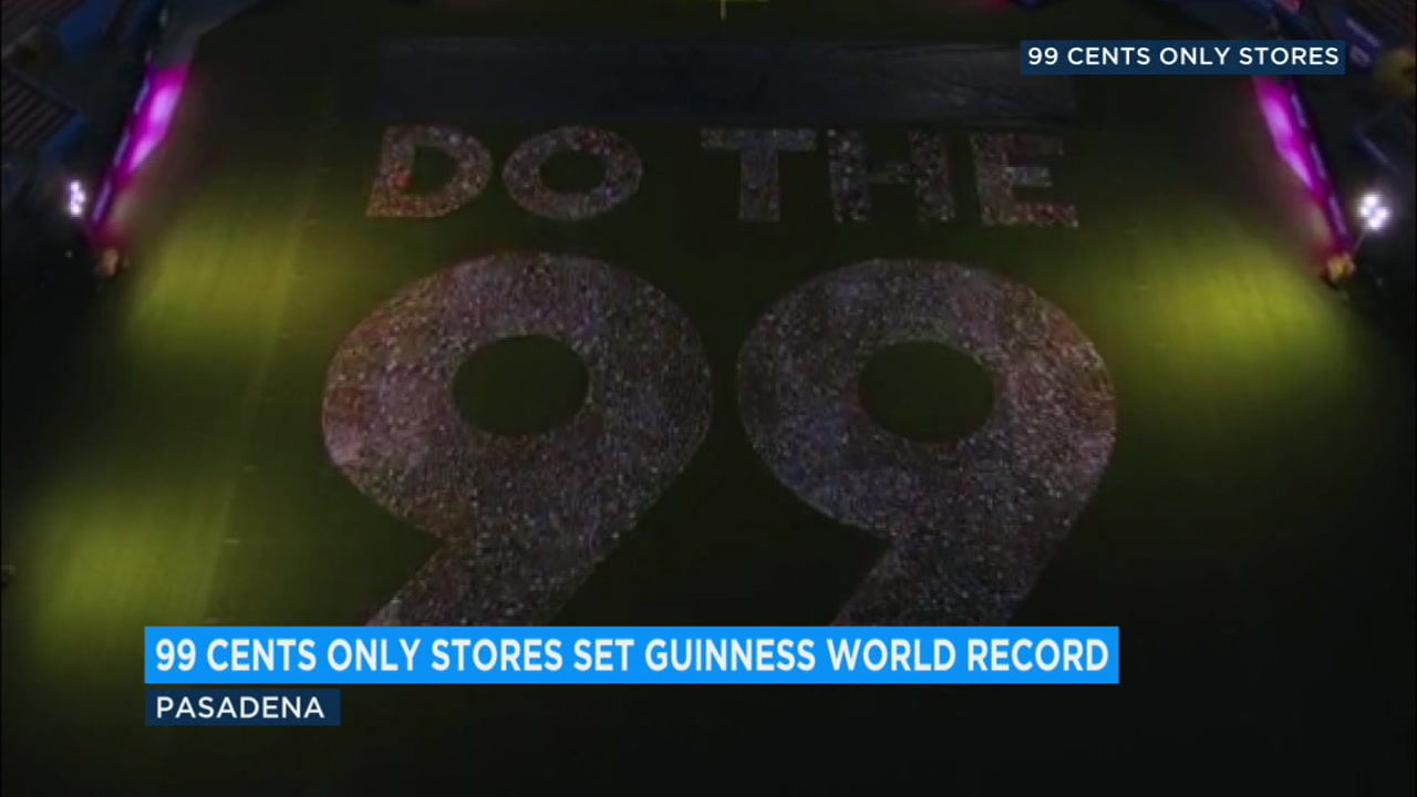 A 99 sign is shown on the floor of the Rose Bowl as part of a world record.