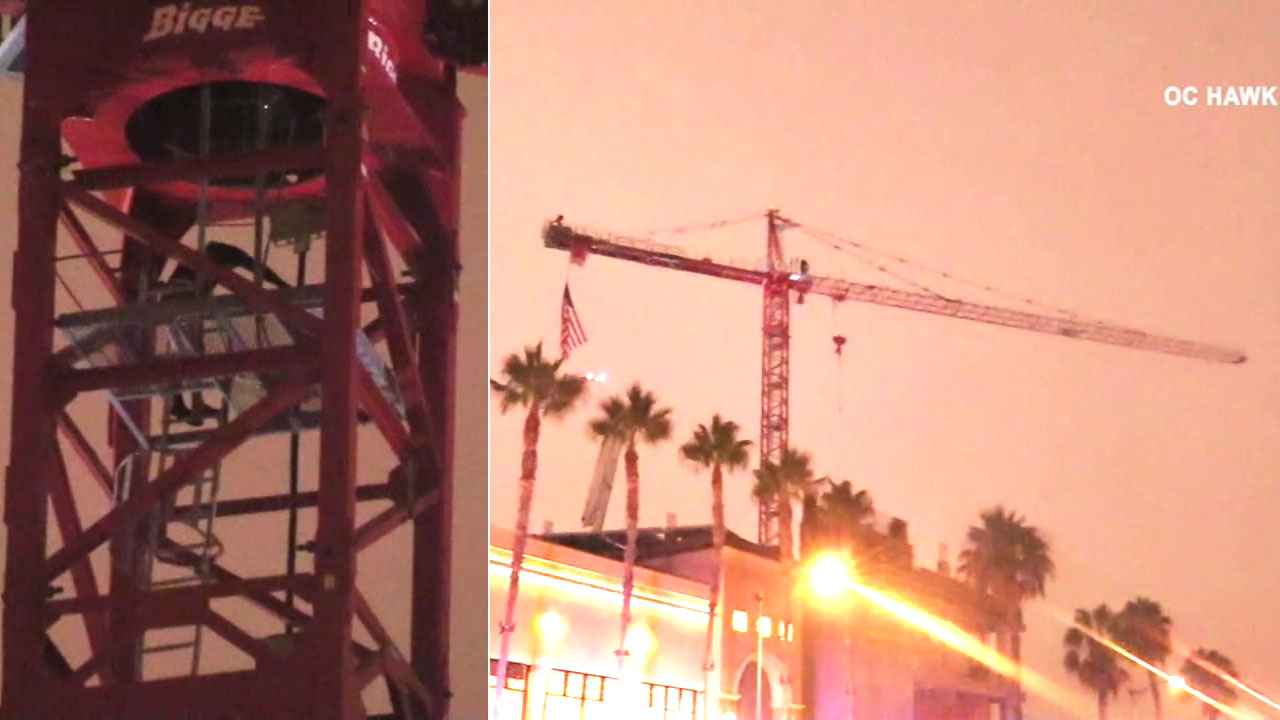A man is in custody after scaling a crane almost 300 feet high at a construction site in Anaheim Sunday night.