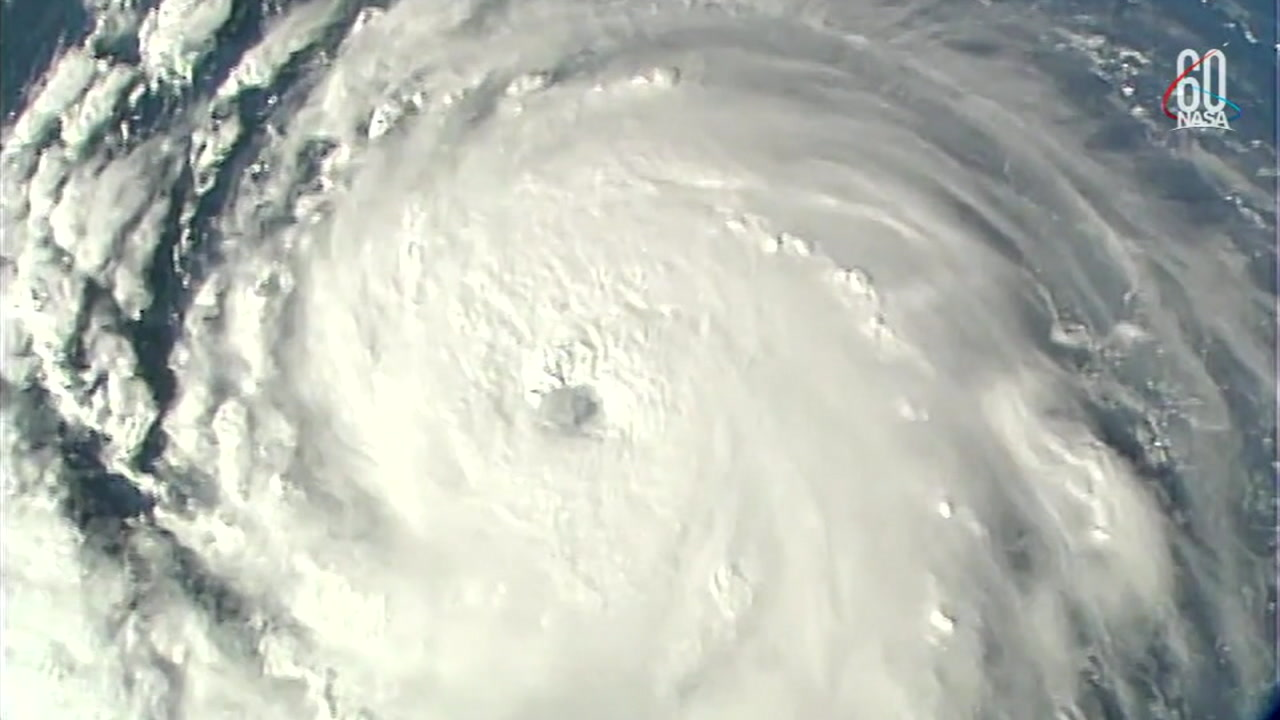 The eye of Hurricane Florence is shown in footage from surveillance satellites in space.