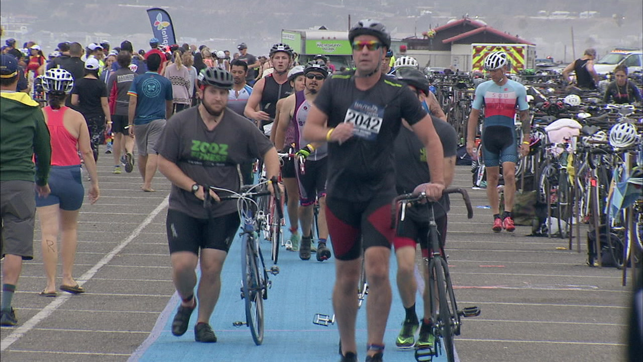 FILE - Runners take part in the Nautica Malibu Triathlon.