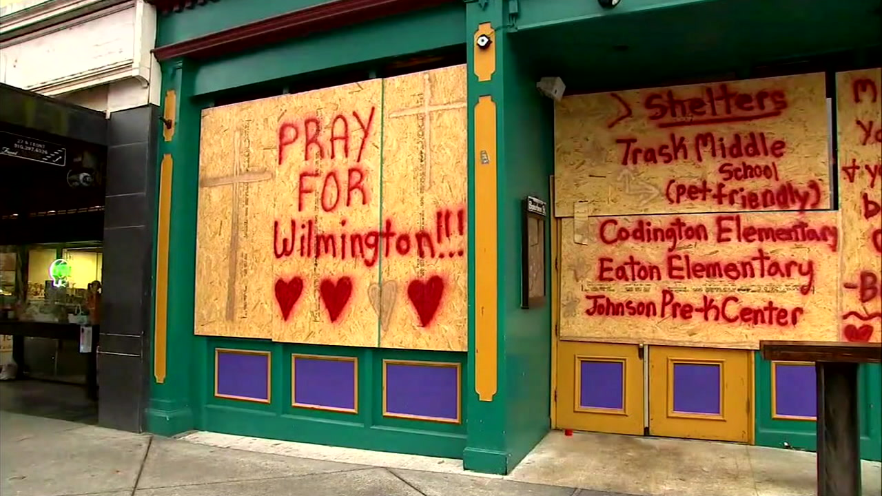 Signs posted to North Carolina shops are shown as people braced for the impact of Hurricane Florence.