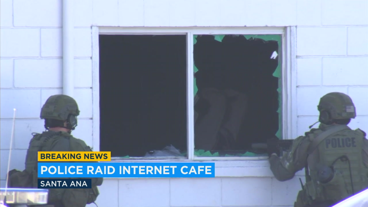 Santa Ana police Thursday raided a cyber cafe that is suspected of being a front for gang activity.