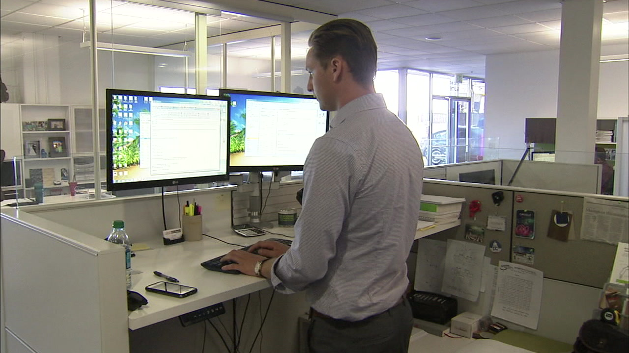 A standing desk can help alleviate problems related to tech neck.