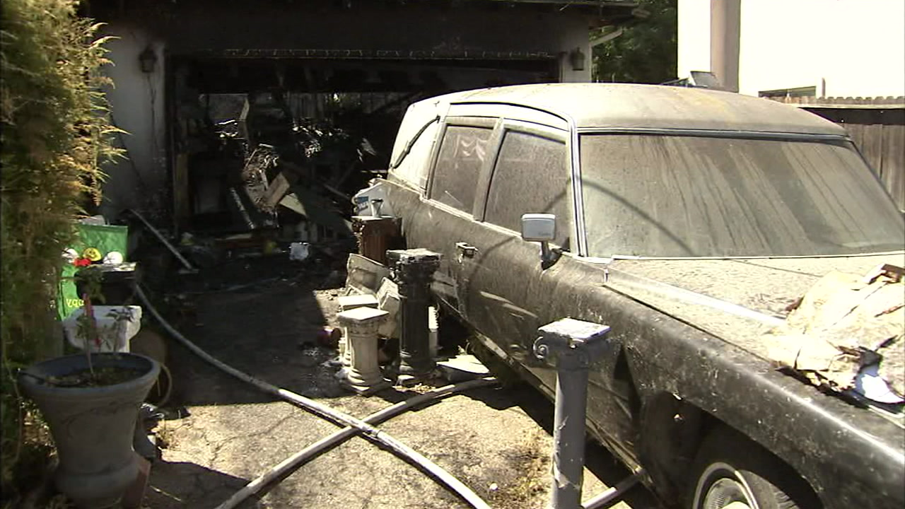 Halloween decorations are shown inside a burned out garage of a Sunland home.
