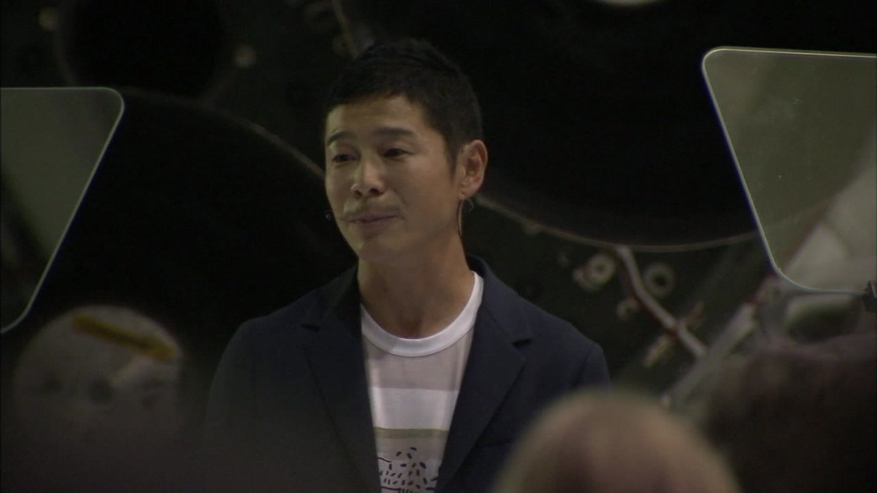 Japanese billionaire Yusaku Maezawa is shown during the announcement that he would travel around the moon in a SpaceX rocket.
