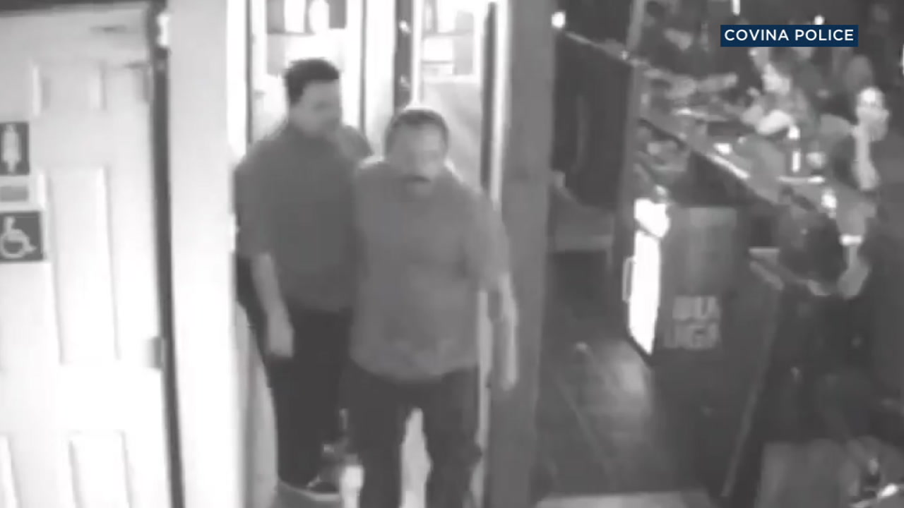 The man with the mustache in this surveillance video is considered a suspect in an assault that left a man unconscious in the restroom of a Covina bar.